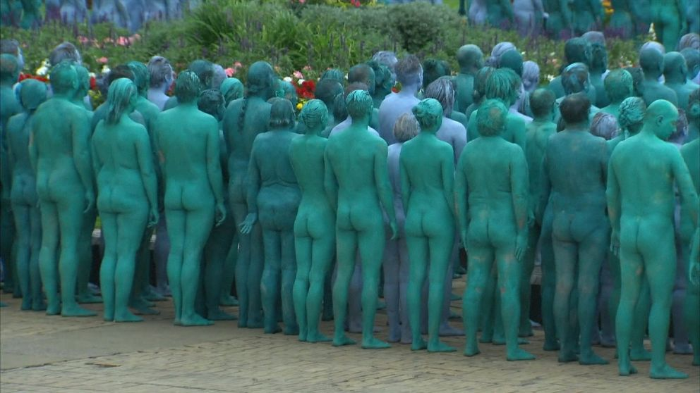 Naked volunteers pose for photographs in Hull.