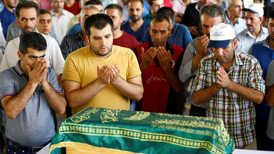 Relatives at the funeral of three-month-old victim Sehriban Nurbay