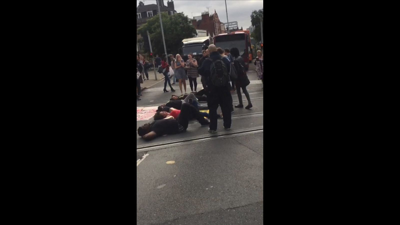 Demonstrators shut down part of the city centre tram and bus network