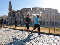 Facebook chief Mark Zuckerberg goes for a jog near the Colosseum