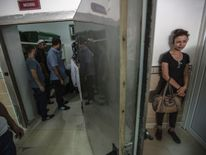 A woman grieves for a victim of the wedding bomb in Gaziantep