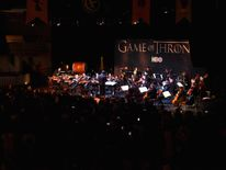 An orchestra performs during the announcement of the Game of Thrones live concert