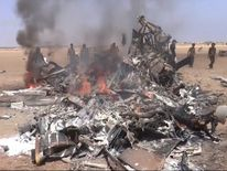 Burning wreckage of the Russian helicopter