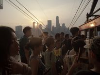 People board a cable car in Chongqing, China