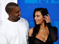Kanye West and his wife Kim Kardashian also put in an appearance