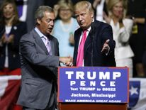Republican Presidential nominee Donald Trump, right, invites United Kingdom Independence Party leader Nigel Farage to speak during a campaign rally