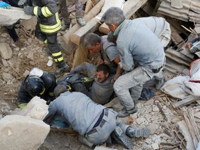A man is pulled alive from the ruins in Amatrice