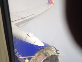 A picture of the damaged engine from inside the plane Pic: Jeremy Martin