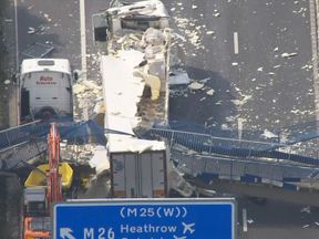 The collapsed footbridge over the M20