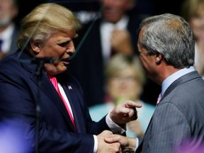 Mr Trump shakes hands with Mr Farage after the speech