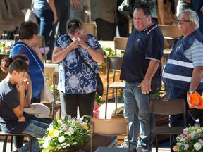 A woman weeps at a funeral for the quake victims