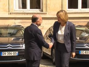 Amber Rudd greets her French counterpart Bernard Cazeneuve
