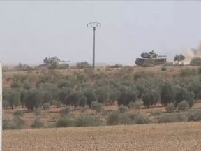 Turkish tanks seen inside Syria as they take on Kurdish forces