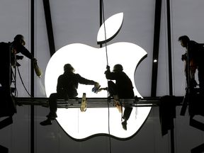 Workers prepare for the opening of an Apple store in Hangzhou, China