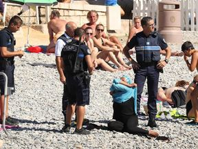 French police tell woman to remove burkini