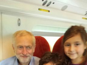 Jeremy Corbyn with two young passengers on the Virgin train (pic: David Rose)