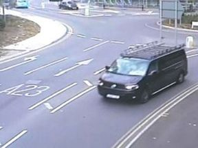 CCTV image of a black modified VW Transporter leaving the Redhill area in Surrey