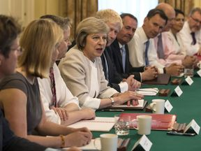 File pic of Theresa May holding the first Cabinet meeting of her new government
