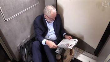 Jeremy Corbyn sits on the floor of a train