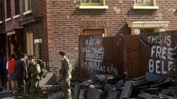 Slogans, soldiers and debris in Falls Road, Belfast.