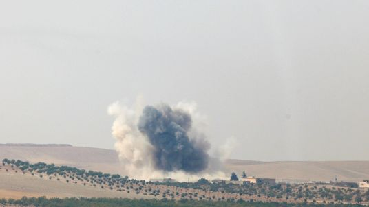 Smoke rises from the Syrian border town of Jarablus, photographed from the Turkish town of Karkamis
