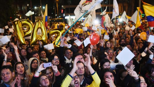 Colombians celebrate the signing of the peace deal with FARC rebels