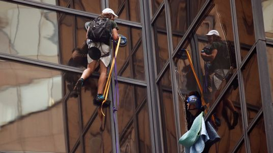 NYPD officers try to detain a man climbing the outside of Trump Tower