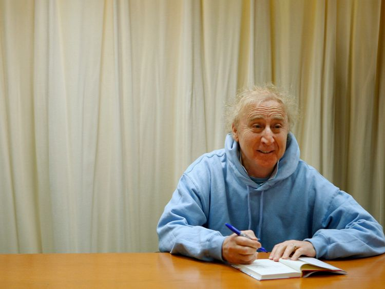 Gene Wilder pictured signing a book in 2008