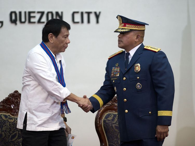 President Duterte shakes hands with the head of the Philippine National Police
