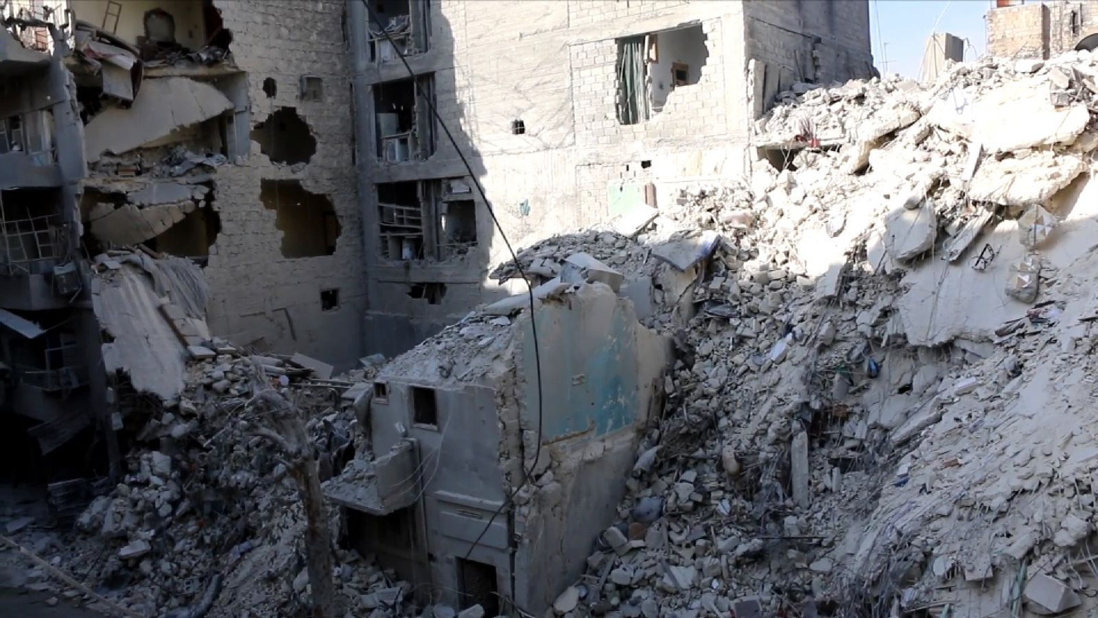 Damage caused to buildings after the Syrian government-led bombing in eastern Aleppo