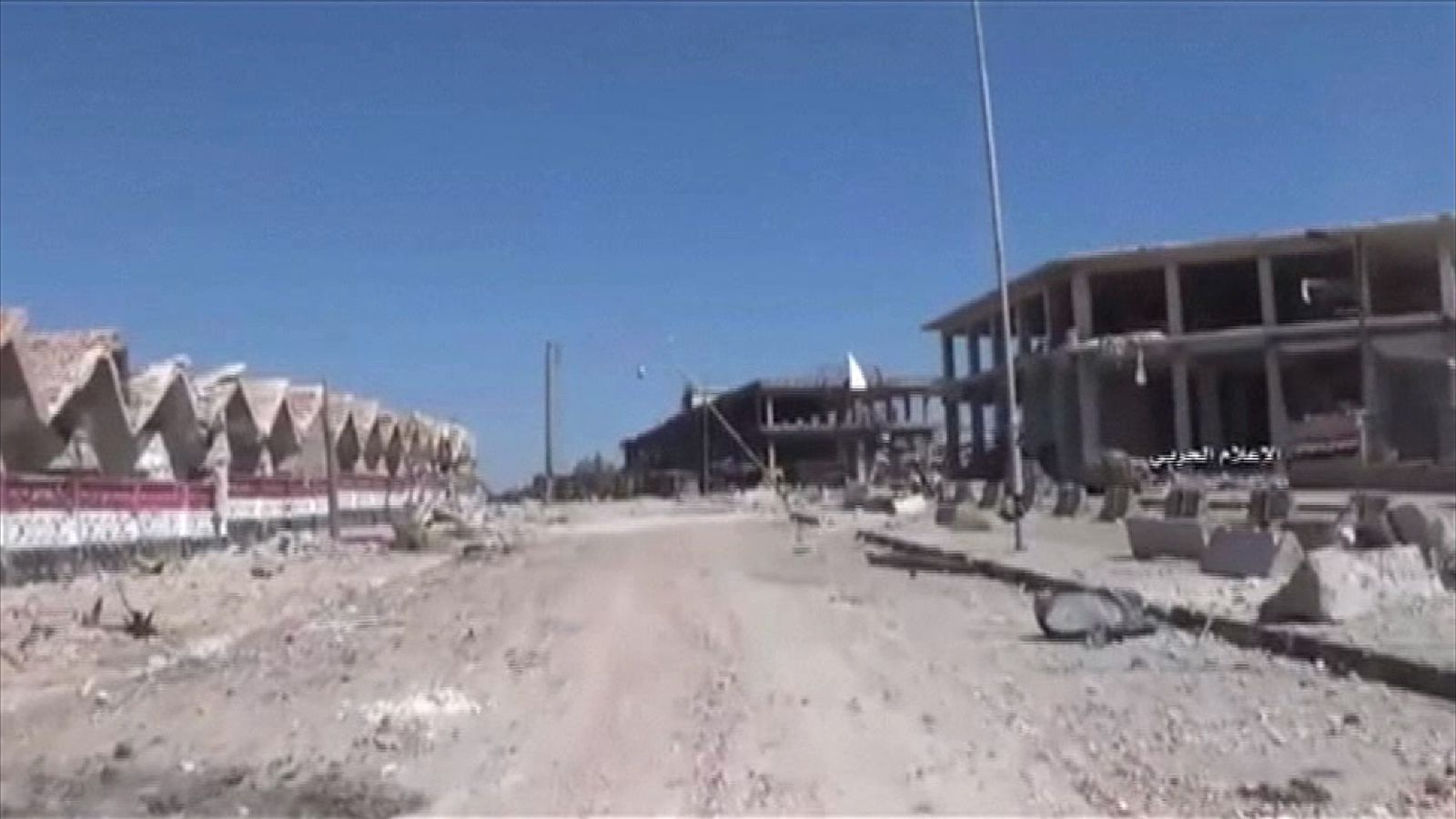 Damage on the streets of Ramouseh, in Aleppo