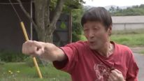 Karate expert Atsushi Aoki fought off a black bear after being attacked while he was fishing. Pic: TBS News
