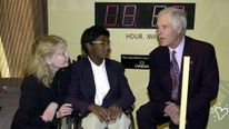 EW YORK, UNITED STATES: US Actress Mia Farrow (L) and her adopted son Thaddeus, whos suffers from polio (C), talk with media mogul Ted Turner (R) before a United Nations conference on the eradication of polio in New York, New York 27 September, 2000. Thaddeus Farrow pushed the button on top of the stand at right which started a count down to the time of a polio-free world in 2005. AFP PHOTO/ Henny Ray ABRAMS (Photo credit should read HENNY RAY ABRAMS/AFP/Getty Images)