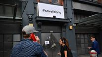 LONDON, ENGLAND - SEPTEMBER 07: People stand outside Fabric nightclub following the announcement of its closure on September 7, 2016 in London, England. Fabric, which opened in 1999 and was voted World Number 1 Club in DJ Magazine's 'Top 100 Clubs Poll' in 2007 and 2008, has had its licence revoked by Islington council, a decision that has been condemned across the political spectrum. (Photo by Carl Court/Getty Images)