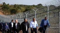 Hungarian Prime Minister Viktor Orban (centre L) and his Bulgarian counterpart Boiko Borisov (centre R) inspect the barbed wire fence on the Bulgaria/Turkish border