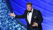 James Corden presenting a gong at the Emmy Awards in Los Angeles