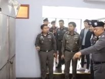 Four men and a woman have been arrested in Thailand after a police officer was shot during a raid which also uncovered a body hidden in a freezer.