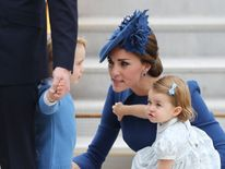 Kate and her children as they arrive in Canada