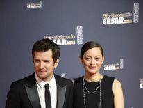 French actor Guillaume Canet (L) and his partner French actress Marion Cotillard
