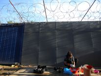 A refugee woman on Hungary's fortified border with Serbia