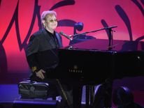 Elton John performing at the Breast Cancer Research Foundation's Hot Pink Party in New York in April 2016
