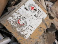 Damaged Red Cross and Red Crescent medical supplies lie inside a warehouse after an airstrike on the rebel held Urm al-Kubra town