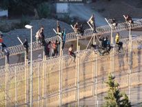 Dozens were left stranded on a fence on the border of the Spanish enclave Ceuta