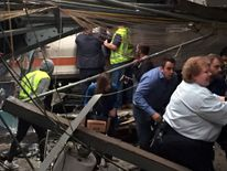 Passengers rush to safety after a NJ Transit train crashed in to the platform at the Hoboken Terminal September 29, 2016 in Hoboken, New Jersey