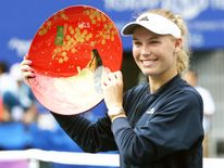 Caroline Wozniacki celebrates winning the Pan-Pacific Open