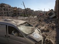 The aftermath of an airstrike in the rebel-held Ansari district of Aleppo