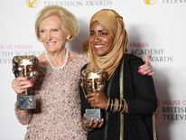 Mary Berry, accepting the Feature award for The Great British Bake Off and Bake Off winner Nadiya Hussain