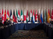 Sergei Lavrov (centre left) and John Kerry (centre) among delegates at the International Syria Support Group meeting in New York