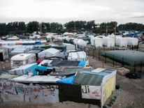 The northside of the so-called 'Jungle' migrant camp in the French northern port city of Calais is pictured on September 26, 2016. French President Francois Hollande said on a visit to the port of Calais on September 26, 2016 that the sprawling 'Jungle' migrant camp would be 'definitively dismantled' under a plan to relocate the migrants to centres around the country. Hollande, on his first visit to Calais as president, also called on British authorities to 'play their part' in assisting the mig