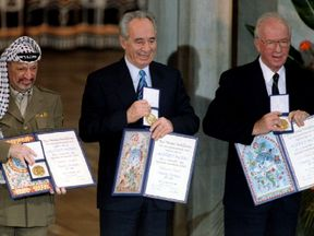 Shimon Peres (centre) receives his Nobel Peace Prize with Yasser Arafat (left) and Yitzhak Rabin (right)